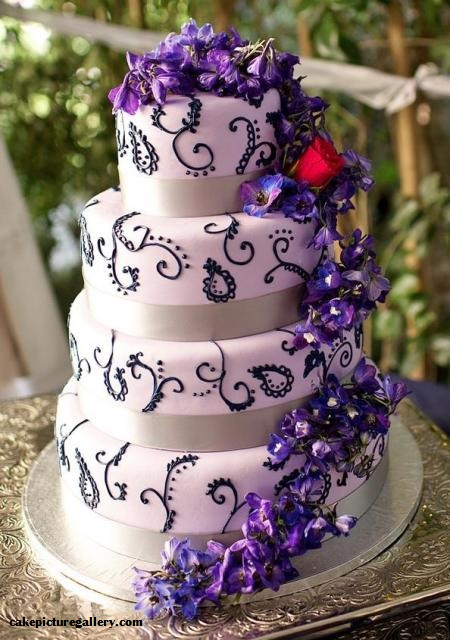 4 layer white cake with purple flowers and motifs
